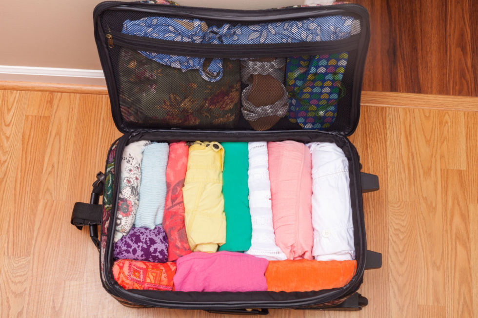 pack suitcase, how to plan a first trip abroad, how to plan a solo backpacking trip