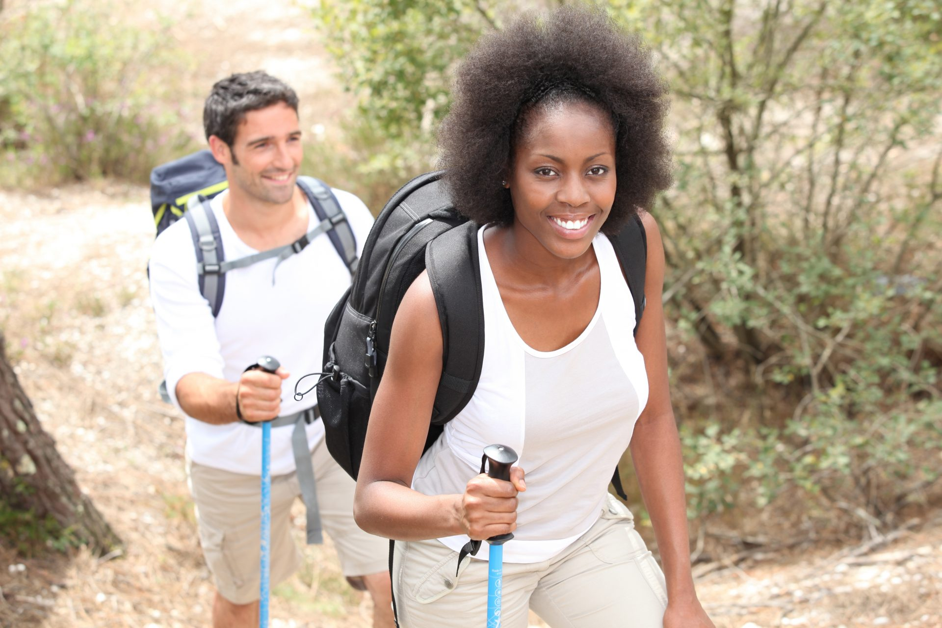 black woman hiker with white man behind, black backers
