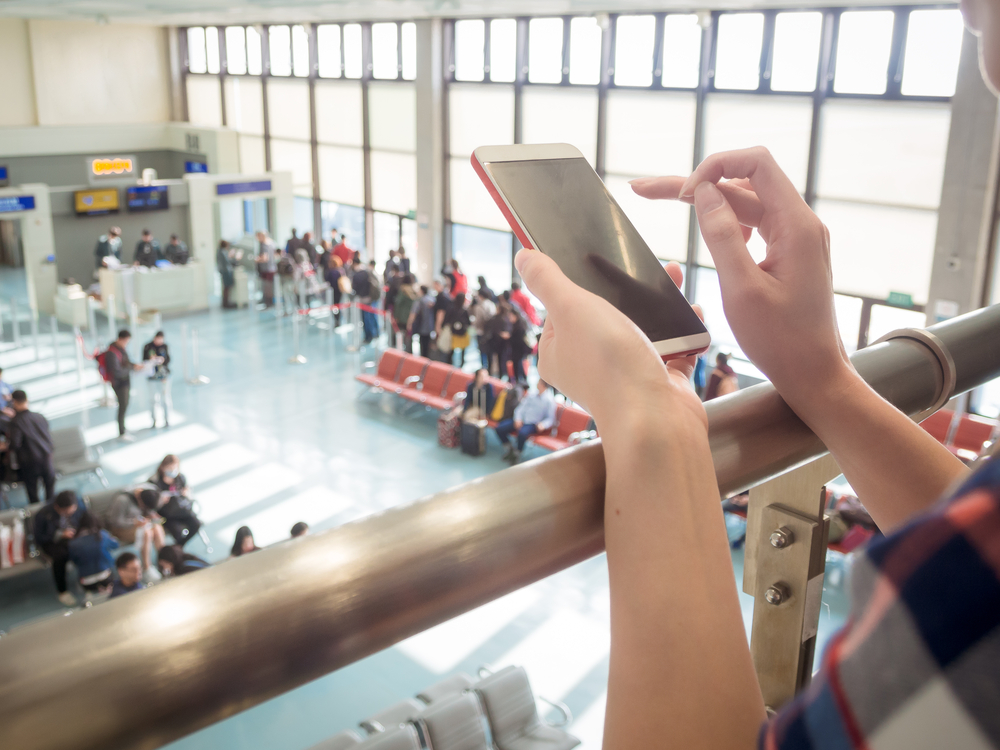 mobile at airport, how to plan a first trip abroad